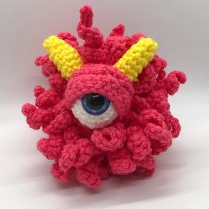 Crocheted eyeball monster